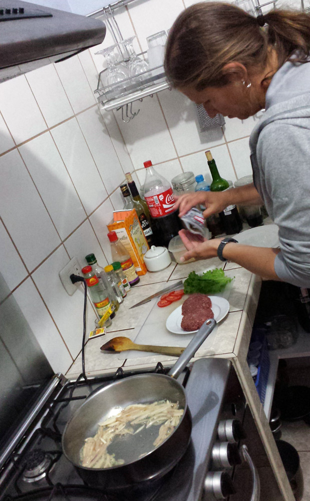 Image of Julie preparing dinner.