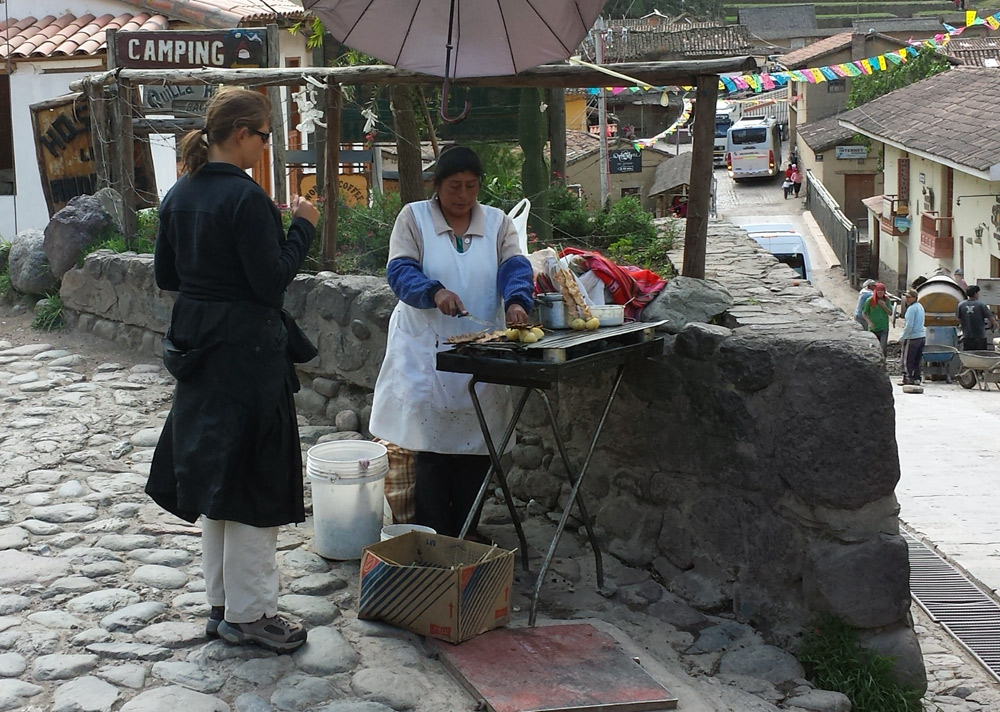 Image of Julie ordering anticuchos in Ollantaytambo.
