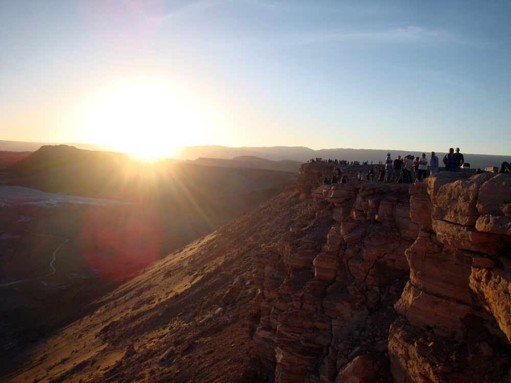 Image of Quite a crowd gathers on the cliffs at Valle de la Luna for sunset.