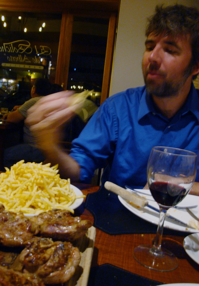 Image of Mark shoveling papas fritas.