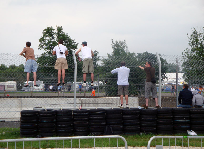 Image of Race fans on fence
