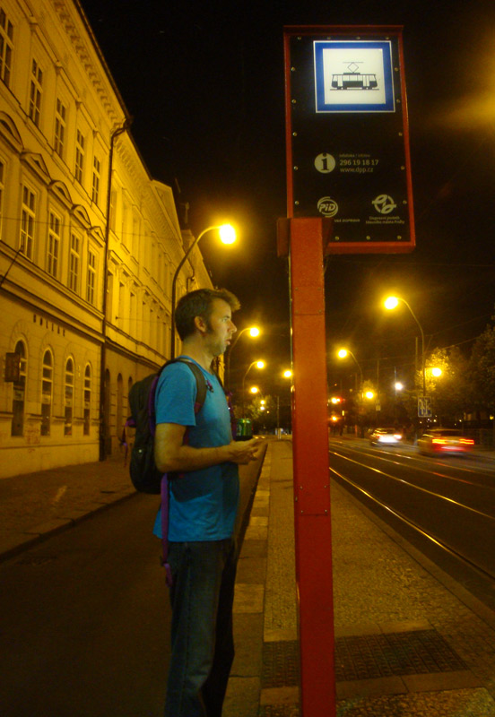 Image of Mark checking the tram schedule