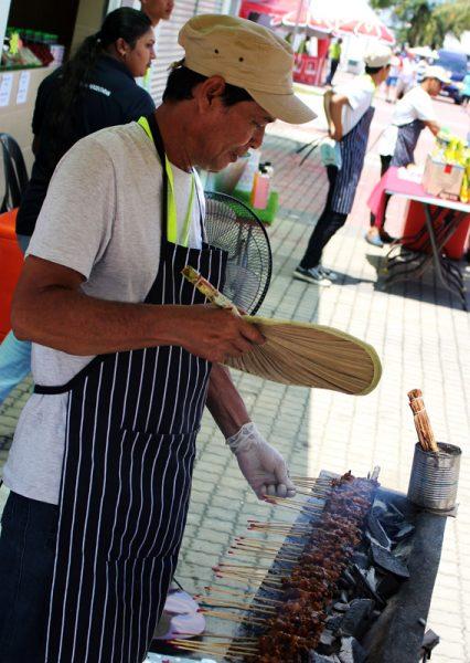 Image of man grilling satay at Sepang Circuit